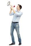 Man som ropar till och med megafonen Royaltyfria Foton