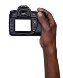 Man som rymmer en kamera Arkivfoton