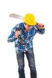 Man som rymmer en machete och en hjälm Arkivfoto