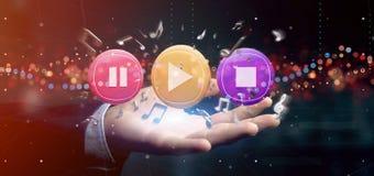 Man som rymmer en musikknapp och anmärkningar som spelar tolkningen 3d Arkivbilder