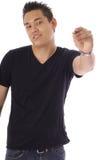 Man som rymmer en penna (fokusen på penna) Fotografering för Bildbyråer