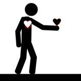 Man som rymmer hans hjärta Arkivfoto