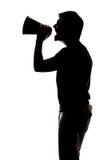 Man som skriker i en megafon Royaltyfri Fotografi