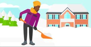 Man som skyfflar och tar bort snö Arkivfoton