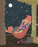Man som sover i hängmatta på stranden Arkivbild