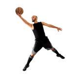 Man som spelar basket på vit bakgrund Arkivbilder