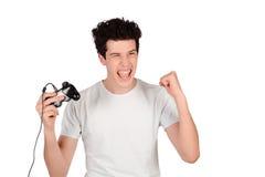 Man som spelar videogames Fotografering för Bildbyråer