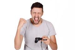 Man som spelar videogames Royaltyfri Bild