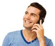 Man som svarar den smarta telefonen mot vit bakgrund Royaltyfri Foto