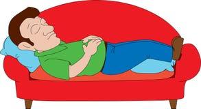 Man som ta sig en tupplur på soffan Royaltyfria Bilder