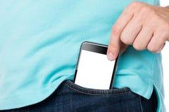 Man som tar bort Apple iPhone 6 från facket Royaltyfria Bilder
