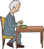 Man som äter på tabellen Fotografering för Bildbyråer