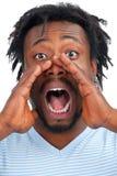 Man som ut loud skriker fotografering för bildbyråer