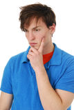 Man with a somber expression. A young man with a somber expression on his face royalty free stock photo
