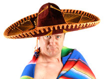 Man in Sombrero. A man wearing a sombrero and a colorful Mexican rug Stock Images