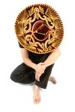 Man in Sombrero. A man dressed in black wearing a ornate sombrero stock photo