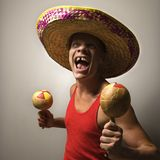 Man with sombrero and maracas. Portrait of a Mid-adult Caucasian male wearing sombrero holding maracas stock photography