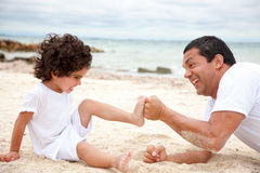 Man and son at the beach Stock Image