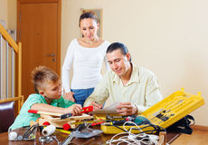 Man with son doing something with working tools Royalty Free Stock Photo