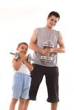 Man and son exercise at gym Stock Photos