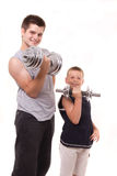 Man and son exercise at gym Stock Images
