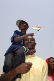 Man with Son in Ghana. March 6, 2007 - TA man holds his son up to better view anniversary celebrations in Accra, Ghana, marking the country's 50th anniversary of Stock Images