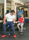 Man and son in the gym Royalty Free Stock Image