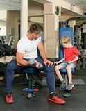 Man and son in the gym Royalty Free Stock Photos
