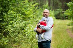 Man and son infant in forest Stock Photos