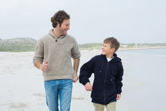 Man and son jogging at beach Royalty Free Stock Photo