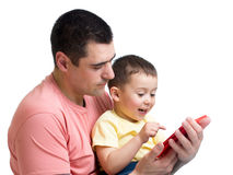 Man and son kid play with tablet computer Royalty Free Stock Image
