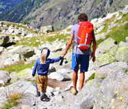 Man with a son in mountains Royalty Free Stock Photo