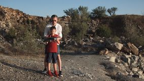 Man and son using drone stock video