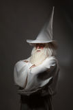 Man in sorcerer costume. A man in a sorcerer costume on a black background Stock Photo