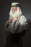 Man in sorcerer costume. A man in a sorcerer costume on a black background Royalty Free Stock Photos