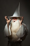 Man in sorcerer costume. A man in a sorcerer costume on a black background Royalty Free Stock Photography