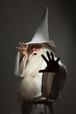 Man in sorcerer costume. A man in a sorcerer costume on a black background Royalty Free Stock Photo