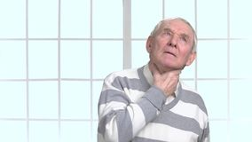 Man with sore throat and cough. Elderly man feeling pain in throat. Elderly sick man having cough stock video footage