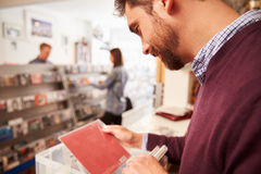 Man sorting through records at a record shop Stock Photography