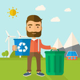 Man sorting a trash. A Caucasian standing outside the house sorting a trash and will throw to the barbage bin. Eco-friendly. A Contemporary style with pastel Royalty Free Stock Photos