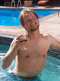 Man in spa with a glass of wine. Royalty Free Stock Photography