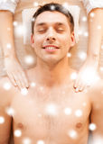 Man in spa salon getting massage Stock Photography