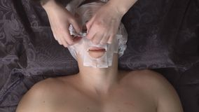 Man in the spa taking a mask.  stock video