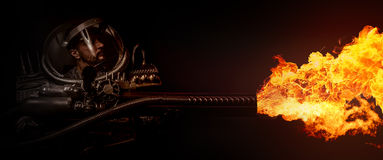 Man in space armor and flamethrowers Stock Images