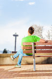Man with space needle on background in park Royalty Free Stock Image