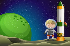 A man in the space standing beside the rocket Royalty Free Stock Images