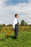 Man and spade. Royalty Free Stock Photos