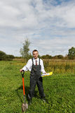 Man and spade. Royalty Free Stock Images