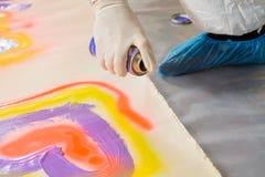 Man spay painting heart shape Stock Image