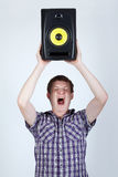 Man with speaker loud shouting Stock Photo